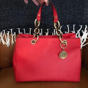 Michael Kors Cynthia Coral Leather Purse.
